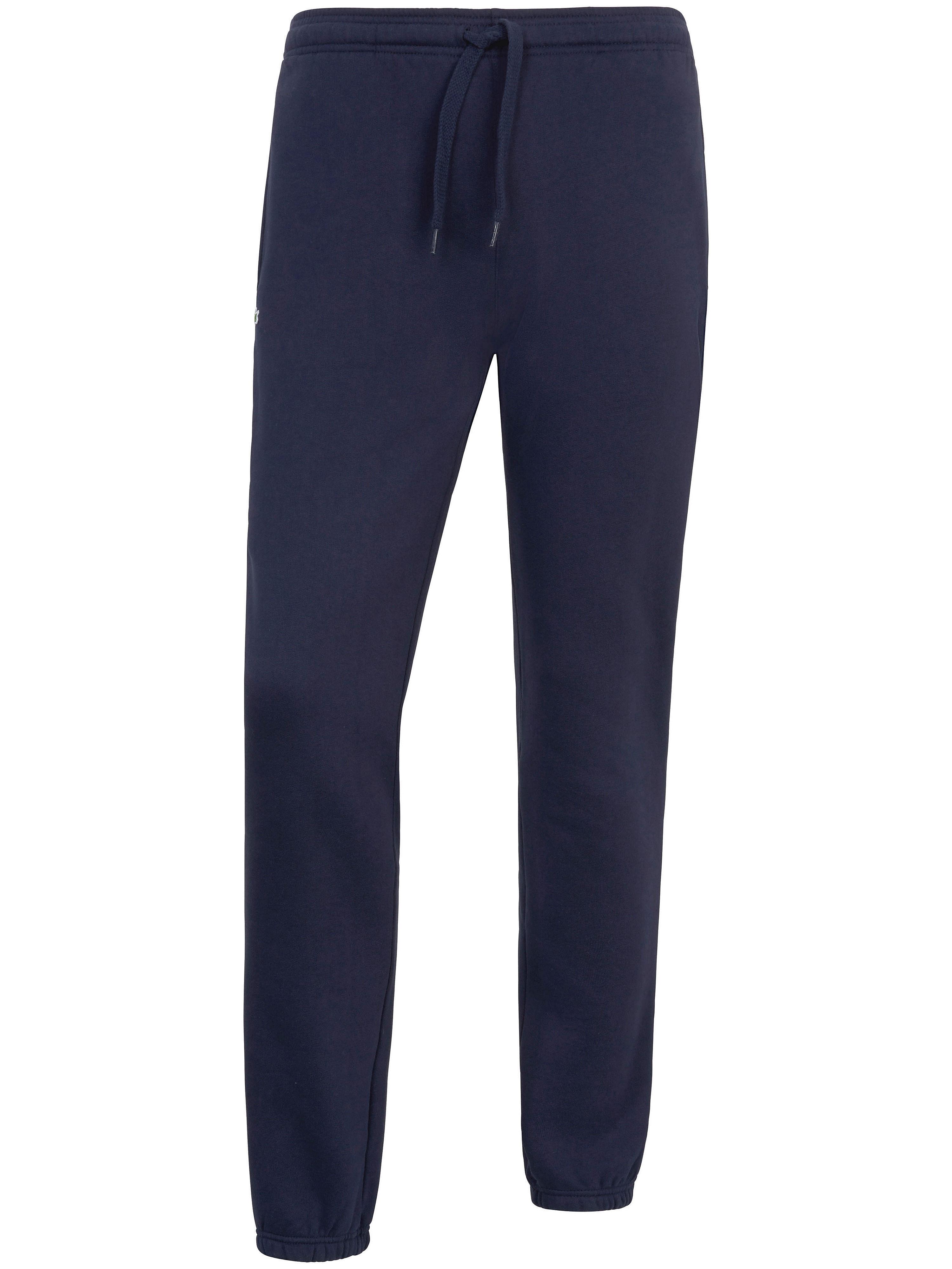 Le pantalon molletonné  Lacoste bleu taille 54